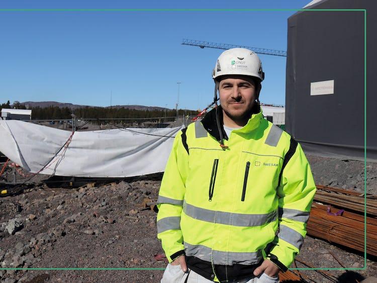 Ionuț Cobzariu at the construction site, dressed in helmet och yellow jacket